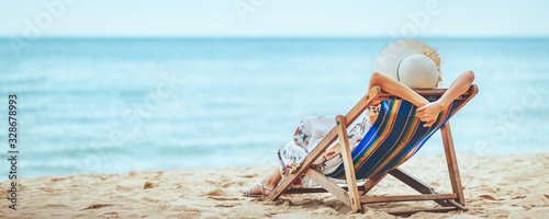 Woman on beach in summer Fototapeta
