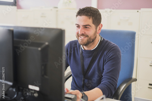 working office worker smiling happy sit down Canvas Print