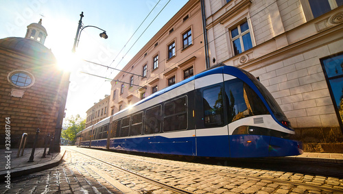 Fototapeta Tram on the street of old town in Krakow, Poland. Cityscape with polish public transport . obraz