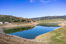 High Angle View Of Anderson Reservoir, A Man Made Lake In Morgan Hill, Managed By The Santa Clara Valley Water District, Maintained At Low Level Due To Failure Risk In Case Of Earthquake; California