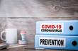 Leinwanddruck Bild - COVID-19, CORONAVIRUS and PREVENTION. Two binders on desk
