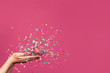 Leinwanddruck Bild - Falling confetti on bright pink background