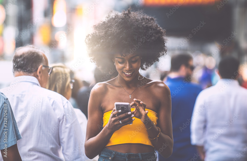 Fototapeta Young beautiful girl walking in Time square, manhattan. Lifestyle concepts about New york