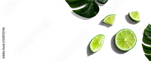 Canvas-taulu Fresh green limes overhead view - flat lay