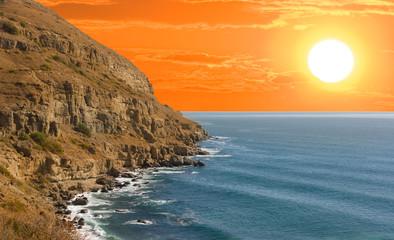 Fototapeta Optyczne powiększenie sea cliff at the red dramatic sunset, sea sunset scene