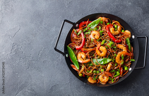 Stir fry noodles with vegetables and shrimps in black iron pan Wallpaper Mural