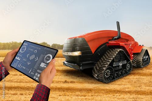 Aufkleber - Farmer with digital tablet controls autonomous tractor on a smart farm
