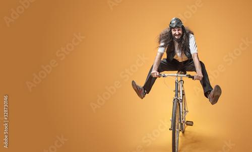Portrait of a skinny nerd riding a bike Canvas