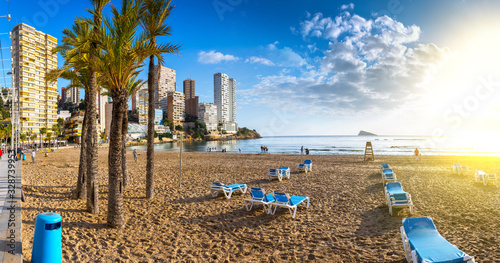 Рanoramic seascape view of summer resort with beach(Playa de Llevant) and famous skyscrapers. Costa Blanca. City of Benidorm, Alicante, Valencia, Spain.