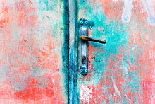 Red Grundge Metal Door With Old Rusty Hinge. Abstract Background Image