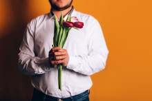 Man Holds Tulips In Hands In A...