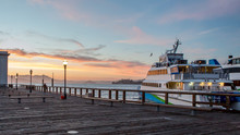 Docked Ferry Against Sunset At...