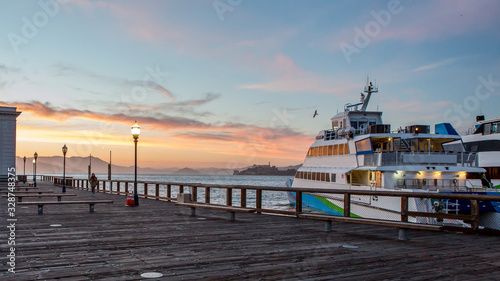 Obraz Docked Ferry Against Sunset At San Francisco Pier - fototapety do salonu