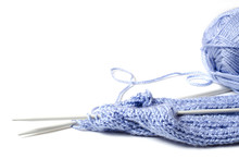 Balls Of Blue Yarn And Knitting Needles. White Background. Copy Space. The Concept Of Women 's Needlework