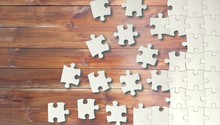 Classic Puzzle Pieces On Woode...