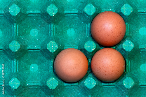 three chicken red egg in a green cardboard made of recycle materials Wallpaper Mural