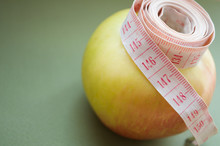 Measuring Tape On An Apple. H...