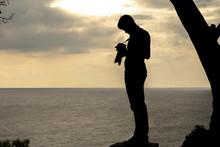 Silhouette Of A Photographer O...