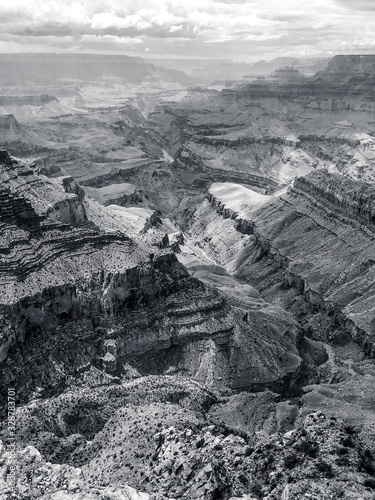 Black and White contrast view of the Grand Canyon from Lipan Point with view of Hance Rapid and the Colorado River.  Grand Canyon National Park, UNESCO World Heritage Site, Arizona