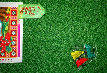 Set for diamond mosaic - stylus, rhinestones, glue. Copyspace