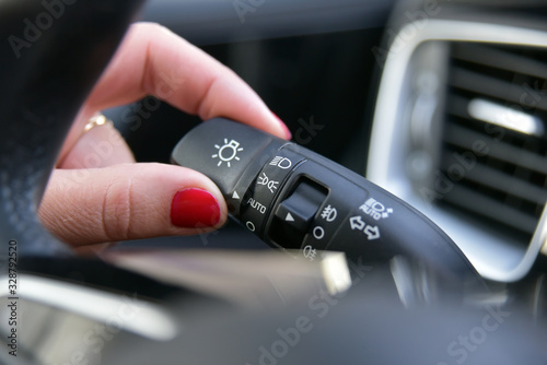 Female finger on the button to activate car lighting Canvas Print