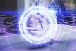 Cryptocurrency hologram, bitcoin, ico theme over hands taking notes background. Concept of blockchain. Multi exposure
