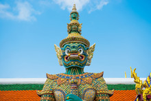 Statue Of Bright Colored And Gold Decorated Mythical Demon Guardian Near Gates In Grand Palace, Bangkok, Thailand