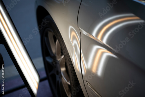 Fotografie, Obraz Before the paintless dent on white car hood