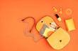 Leinwanddruck Bild - Flat lay with woman fashion accessories in yellow color over orange yellow textured background. Fashion, online beauty blog, summer style, shopping and trends idea