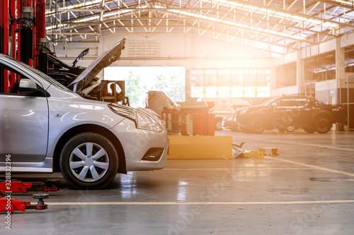 Fototapeta car in repair station and body shop with soft-focus and over light in the background obraz