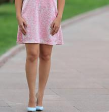 Beautiful Legs Of A Girl In A Mini Skirt