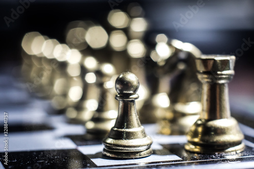 Fotografie, Obraz Chess figures on a dark background with smoke and fog