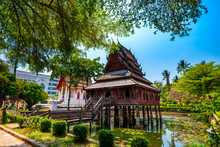 Beautiful Of Tripitaka Storage Tower.Thai Wooden Temple Architecture In The Middle Of Pond At Wat Thung Si Muang In Ubon Ratchathani Province, Thailand,ASIA.