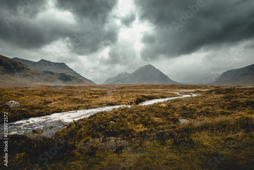 Fototapeta Spectacular view of the mountain in Scottish Highlands on a rainy day obraz
