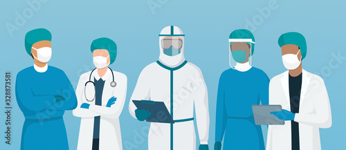 Professional doctors and nurses wearing protective suite and standing together t Fototapet