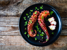 Barbecue Octopus On Wooden Table