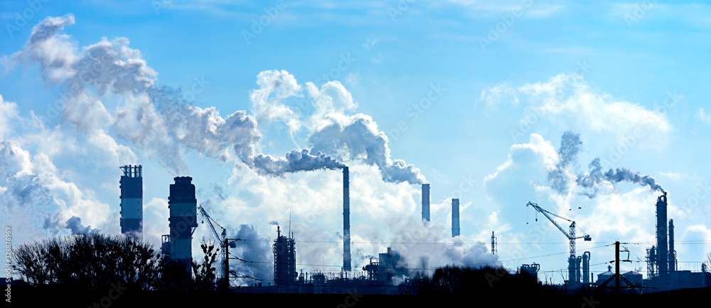 Fototapeta Air pollution from smoke coming out of factory chimneys.