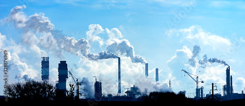Obraz Air pollution from smoke coming out of factory chimneys. - fototapety do salonu