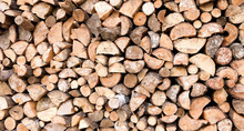 Large Rural Stack Of Firewood. Old Firewood. Background.