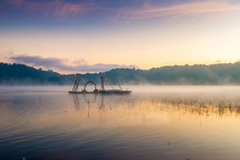 A Boat Floats In The Lake On A...