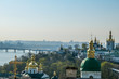 Green and golden rooftops of Pechersk Lavra Monastery, known as Kiev Monastery of the Caves, located at the shore of Dnieper. Historic Orthodox Christian monastery. Splendid, glamorous looking church