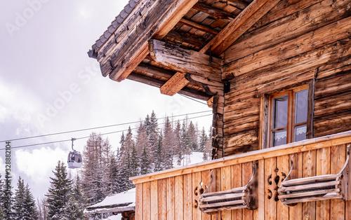 Fényképezés Wooden mountain house and ski lift, Rauris, Austria