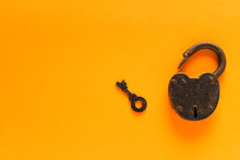 Old Padlock With Key On A Oran...
