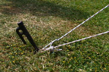 Fix The Tent String With Pegs