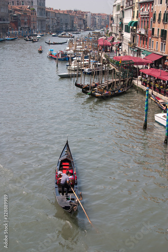 view of Venice showing a gondola in the foreground on the Grand Canal in the hea Fototapet
