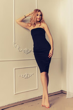 Fashion Woman Portrait Sexy In Black Dress Hot Summer Near White Background