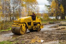 Construction Of A New Road. Roller For Asphalting. Earthwork. Rolling, Compaction Of Gravel.