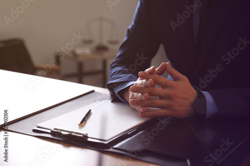 Male lawyer at table in office, closeup Wallpaper Mural