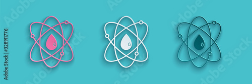 Paper cut Atom icon isolated on blue background Wallpaper Mural