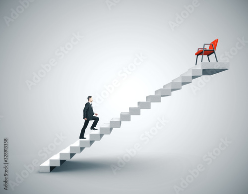 Photo Businessman in suit climbing to chair